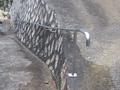 石積法面壁付きスロープ手摺